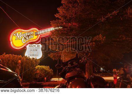 Flagstaff Arizona - September 26 2015; Museum Club Giant Guitar Neon Sign Illuminated On Dark Night