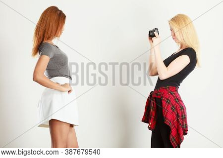 Photographer And Model. Blonde Girl Shooting Images, Taking Photos With Camera, Photographing  Femal