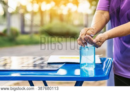 Blue Alcohol Gel Bottle And A Register Book On The Table For Athletes To Prevent Corona Virus (covid