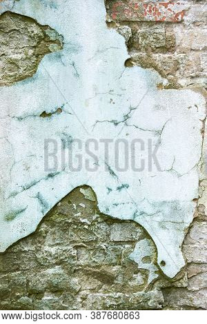 Destroyed Plaster On An Old Brick Wall, Background.