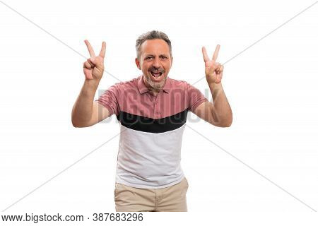 Friendly Adult Man Model Smiling Holding Fingers As Victory Or Peace Sign Gesture Wearing Colourful