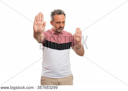 Angry Male Model With Serious Annoyed Expression Making Stop Stay Away Gesture Using Both Hands Palm