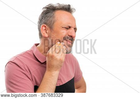 Adult Male Person Touching Cheek Making Hurting Expression As Toothache Pain Gesture With Blank Copy