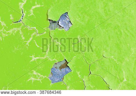 Texture background of light green peeling paint, texture of peeling paint, texture surface, peeling paint texture, texture background of peeling paint. Texture of paint on the texture concrete surface