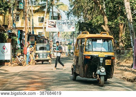 Patnem, Goa, India - February 16, 2020: Auto Rickshaw Or Tuk-tuk Moving On Street In Sunny Day.