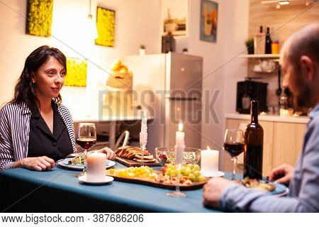 Relationship Anniversary In Dining Room Of Cheerful Couple In Dining Room. Talking Happy Sitting At