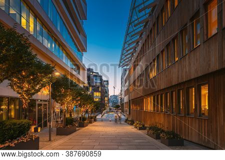 Oslo, Norway. Night View Embankment And Residential Multi-storey Houses In Aker Brygge District. Sum