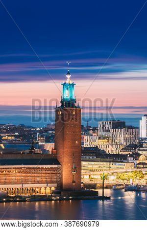 Stockholm, Sweden. View Of Famous Tower Of Stockholm City Hall. Popular Destination Scenic In Sunset
