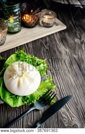 Traditional Italian Dish Of Burrata Stratocell. Burrata On A Lettuce Leaf Is Served For A Romantic D