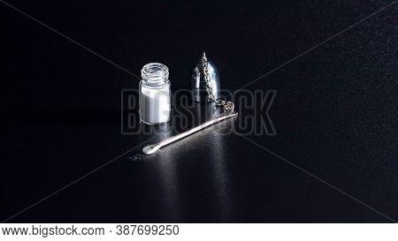 Cocaineon A Black Background, Cocaine Bottle,drug Abuse