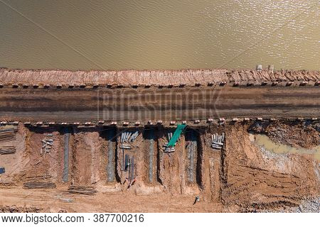 Aerial View Between Bridge Construction Site Work With Bypass Road. Top View Construction Bridge Ove