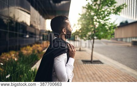 Stylish Attractive Indian Muslim Business Man Standing Outside Modern Glass Walled Building. Looking