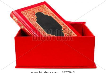 Red Cover Book With Golden Ornament In Red Cardboard Box