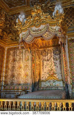 Versailles, France - August 28, 2019 : Marie Antoinette Majestic Bed In The Bedchamber Lavishly Deco