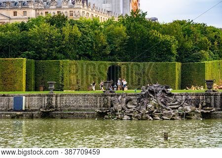 Versailles, France - August 27, 2019 : Neptune Fountain In Gardens Of Famous Versailles Palace. Pala