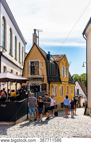 Visby, Sweden - July 27, 2020: Summer City View Of People At The Famous Landmark Building Cafe Resta