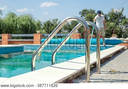 Dirty Outdoor Pool. Cleaner Of Swimming Pool. Man Cleaning Outdoor Swimming Pool With Vacuum Tube Cl