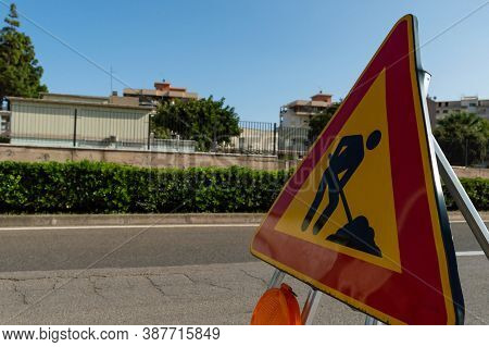 Close Up Triangle Sign Work In Progress. Roadworks, Road Signs. Men At Work. Some Signs Signage For
