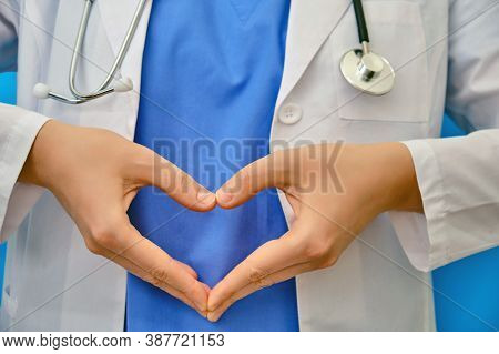 The Doctor's Hands Show A Heart-shaped Gesture, Close-up. The Nurse Folded Her Fingers In The Shape