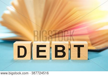 Wooden Blocks With The Word Debt. Reduction Or Restructuring Of Debt.