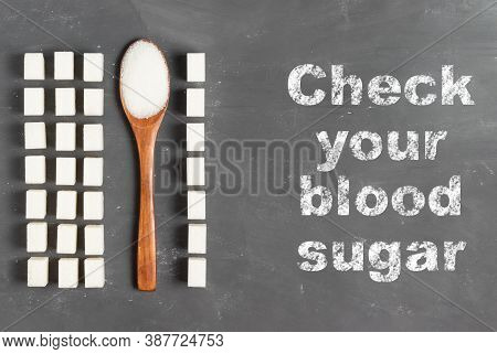 Lettering Check Your Blood Sugar Level With Chalk On A Gray Background With Sugar Lumps And An Eco W