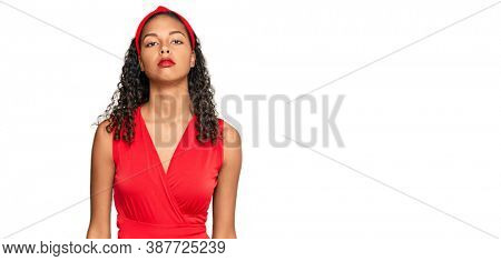 Young african american girl wearing elegant and sexy look relaxed with serious expression on face. simple and natural looking at the camera.