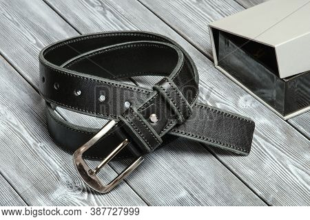 The Belt Is Rolled Up, Next To A Gift Box. Template For The Design Of Leather Accessories. Backgroun