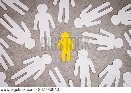 Yellow Paper Figure Of Children Stands Alone. White Silhouettes Of People Around Him. Kid Without Pa