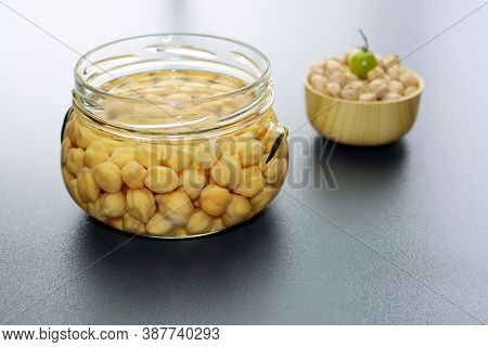Soaking Chickpeas In Water To Ferment Cereals And Neutralize Phytic Acid. Small Glass Jar With Chick