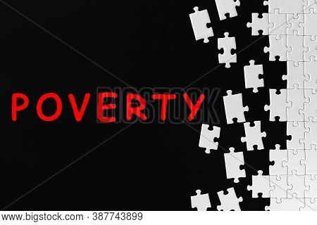 Red Inscription, Text, Word On Black Background. White Gray Puzzles Are Scattered On Right Side Of C
