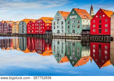 Trondheim, Norway. Colorful Timber Houses And Nidelva River In The Old Town District.