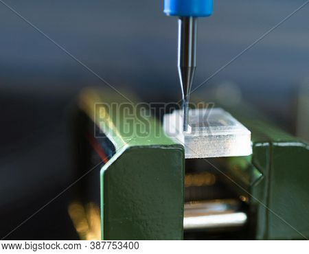 CNC milling machine processing plastic detail.Cutting plastic  modern processing