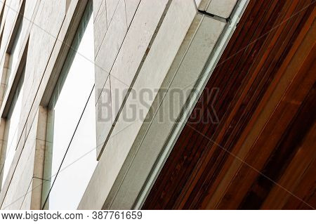 Modern Facade Cladding With Stone And Ceiling Paneling With Wood