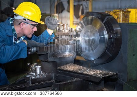 Experienced Operator Caucasian Man, Technician Working Diligently To Get Quality Work Pieces At The