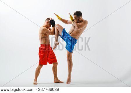 Two Men Boxers Fighting Muay Thai Kickboxing White Background