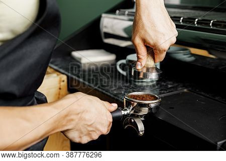 Woman Coffee Shop Worker Preparing Coffee On Professional Coffee Machine