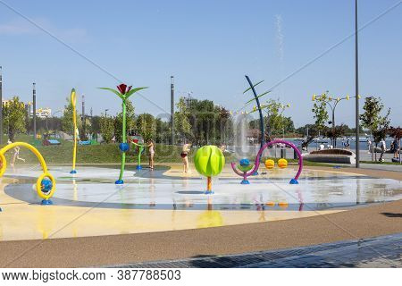 Dnepr, Ukraine - August 26, 2020: Children Play On A Playground In A New Park On The City Embankment