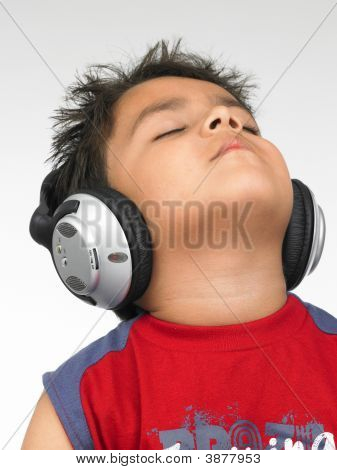 Asian Boy Of Indian Origin With Enjoying Music