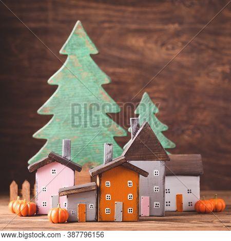 Miniature Thanksgiving Day Little Fairy Autumn Cottages, Pumpkins, Wooden Background, Postcard Conce