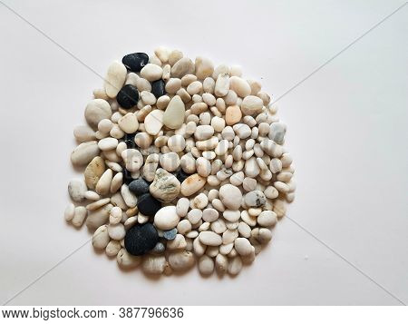 A Mixture Of White Pebbles And Black Pebbles. Background Of Pebbles