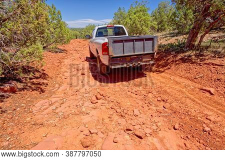A 4x4 Pickup Truck Traveling On A Very Rocky And Rough Section Of Forest Service Road 573 In Prescot