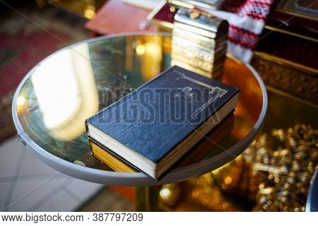 Orthodox Religion. Hands Of The Priest On The Bible.