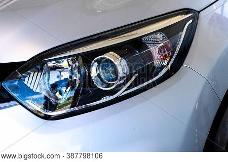 The Front Light Of The Car. Modern Halogen Lighting. Front Lighting Of A Silver Car