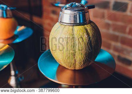 Hookah Tobacco Concept: Melon. Fresh Melon With Lobules. Hookah And Fruits On Dark With Shisha Smoke
