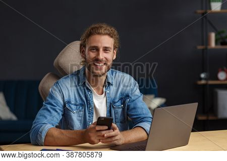 Young Man Using Smartphone And Smiling. Happy Businessman Using Mobile Phone Apps, Texting Message,