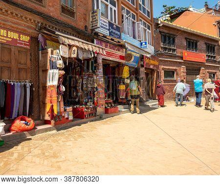 Kathmandu, Nepal - October 2019: Shopping And Souvenir Shops Near The Boudhanath Temple Complex. Str