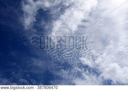 Fluffy Clouds Pattern In A Blue Sky Of Oahu, Hawaii.