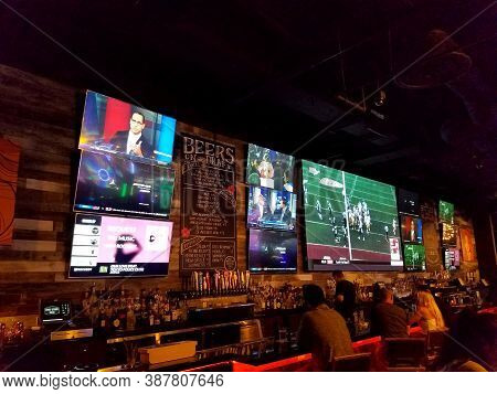 Honolulu - September 29, 2017: People Watch Nfl Football And Other Sports On Large Hd Tv Screens At