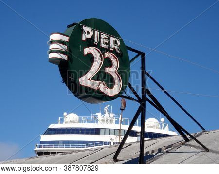 San Francisco - September 24, 2009: Pier 23 Cafe Restaurant And Bar Neon Sign On The Roof With Cruis