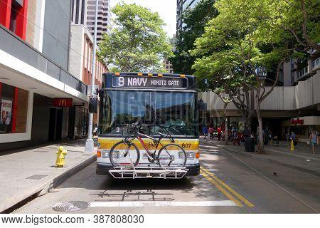 Honolulu - September 8, 2014:  Honolulu City Bus, Number 9 Navy Nimitz Gate, On Busy Hotel Street In